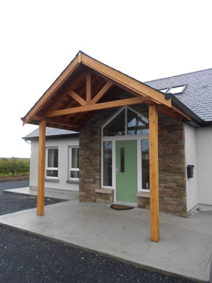 A large expertly crafted entrance in timber, slate and stone invites any visitor to this home to a warm welcoming house.