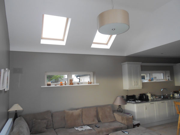 The high ceilinged lounge area in the open plan space that also includes a modern ivory curved corner kitchen with stone worktops and a large dining area completing the space making it an ideal for entertainment.